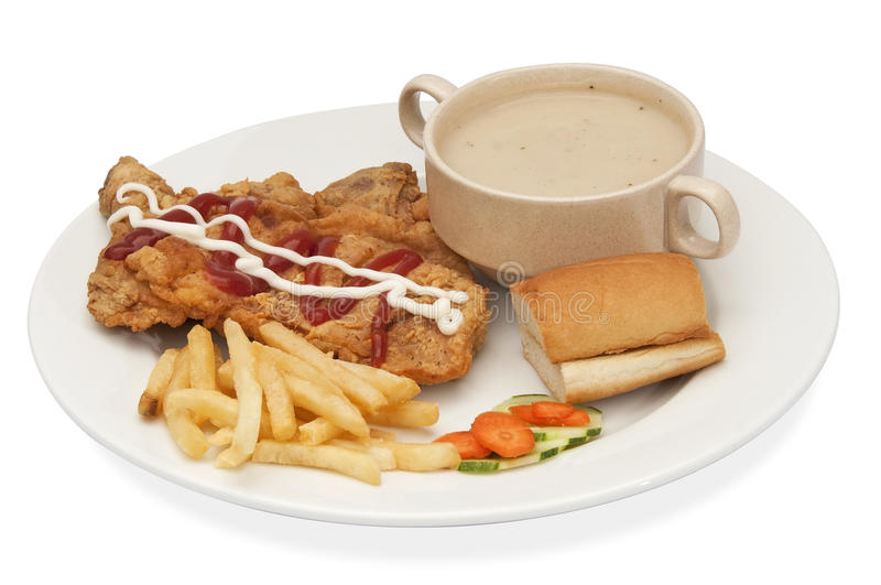 Chicken steak. A fried chicken lunch with french fries and salad stock photos