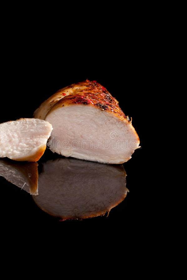 Chicken steak on black. royalty free stock photography
