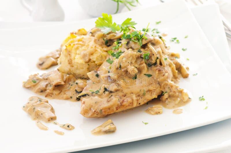 Chicken steak with mushroom sauce stock photos