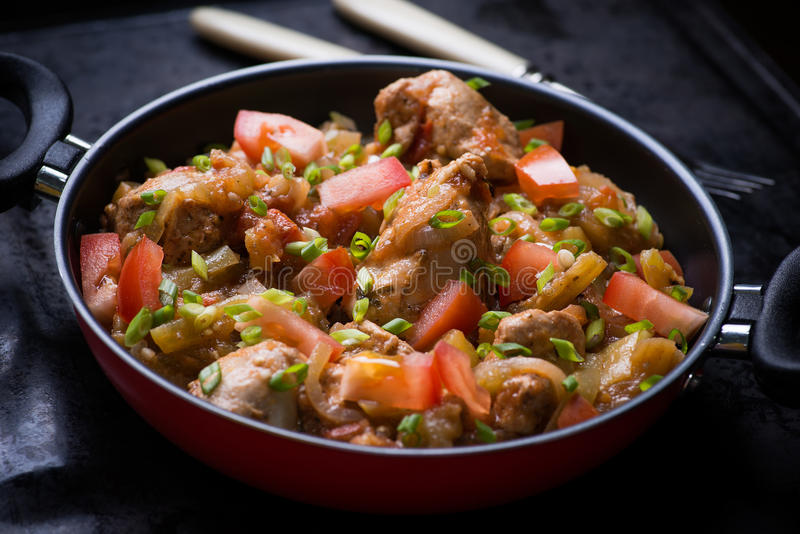 Chicken stew with onion, pepper ant tomato royalty free stock images