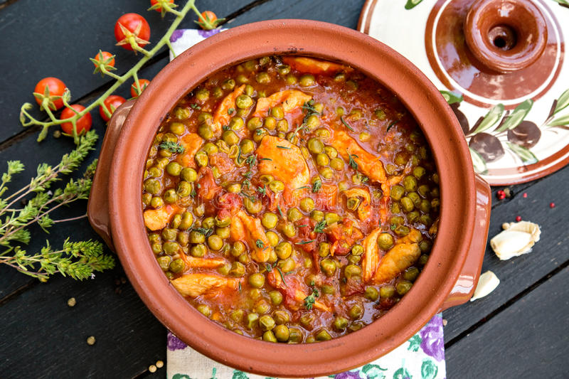 Chicken stew with peas and tomatoes. Tasty chicken stew with peas and tomatoes stock photo