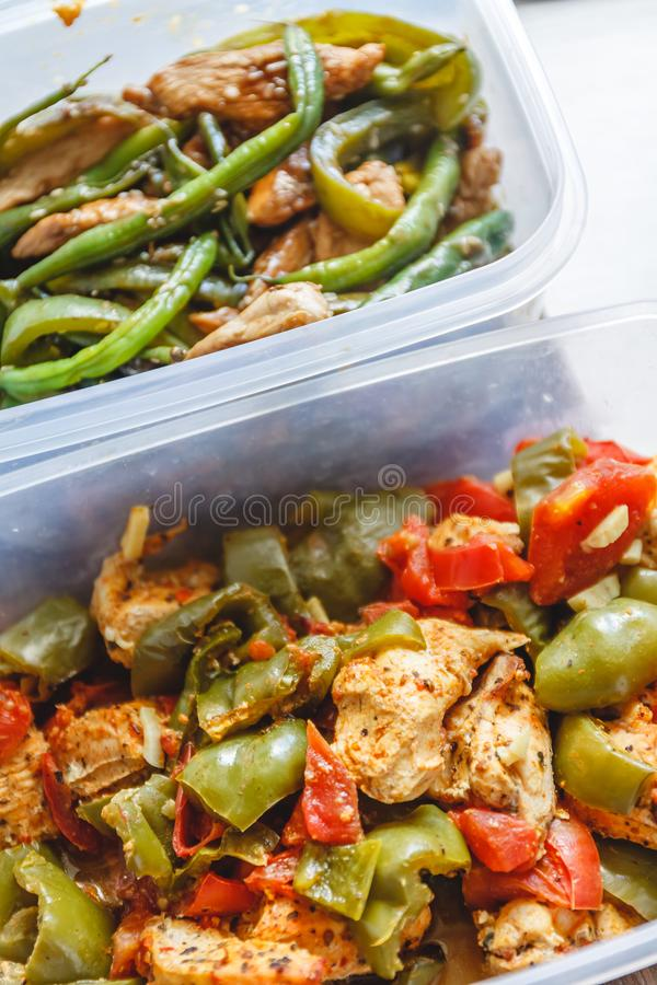 Chicken stew and various vegetables-pepper, tomato, zucchini, asparagus beans in plastic vessels for storage in the refrigerator stock images