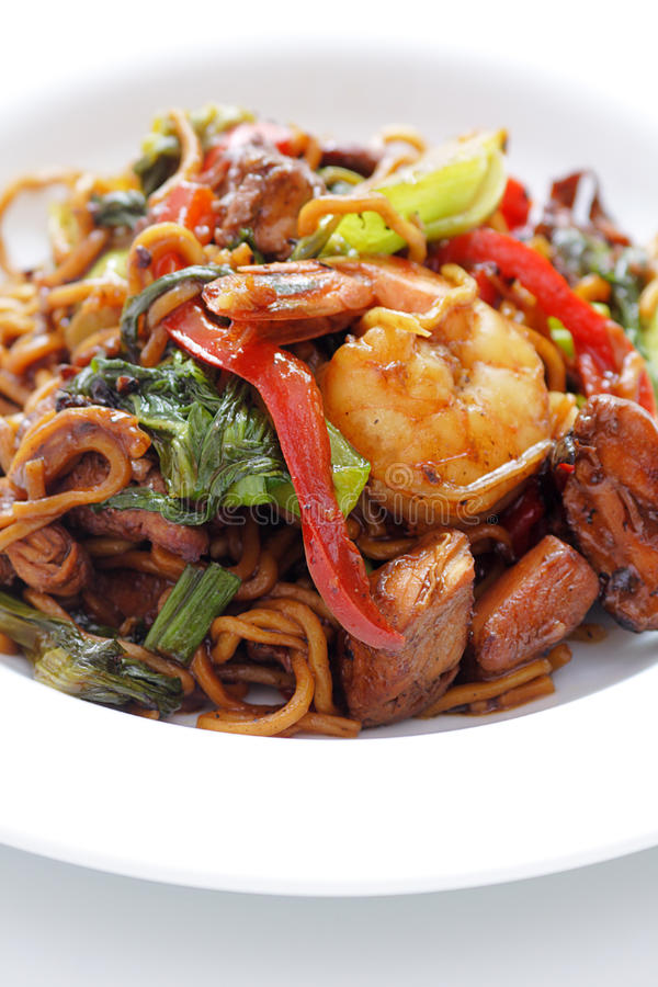 Chicken stir fry. Colorful presentation of chicken shrimp and vegetables stir fried royalty free stock photography