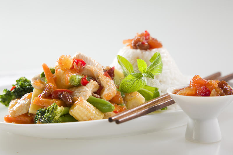 Chicken Stir fry. Asian Chicken Stir Fry with Rice, Chutney and Chopsticks royalty free stock photos