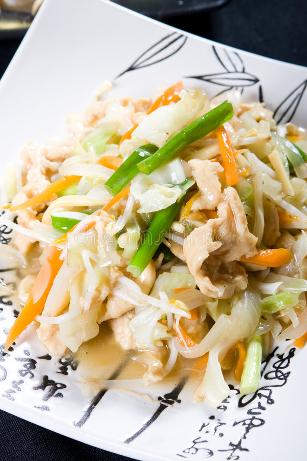 Chicken stir fry. Chinese food - chicken stir fry with veggies royalty free stock images