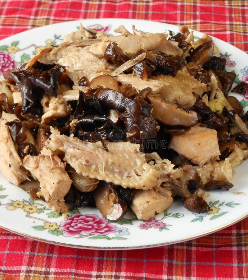 Chicken stir fry. Chinese chicken stir fry with mushroom royalty free stock photo