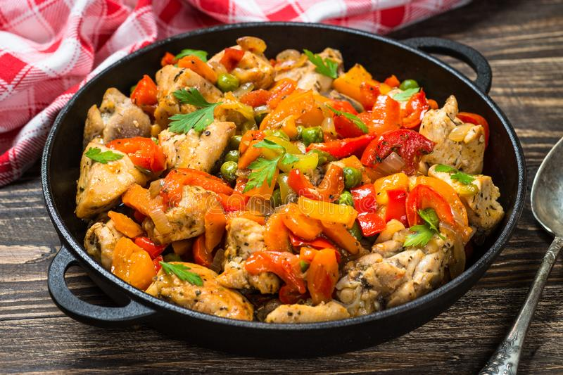 Chicken Stir fry with vegetables on wooden table. stock photography