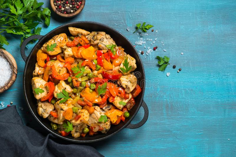 Chicken Stir fry with vegetables on blue table. stock photography