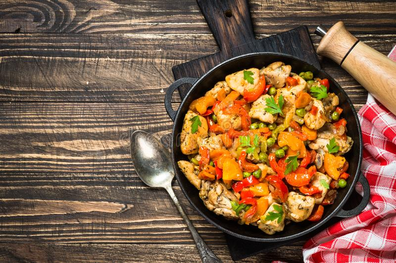 Chicken Stir fry with vegetables on wooden table. stock image