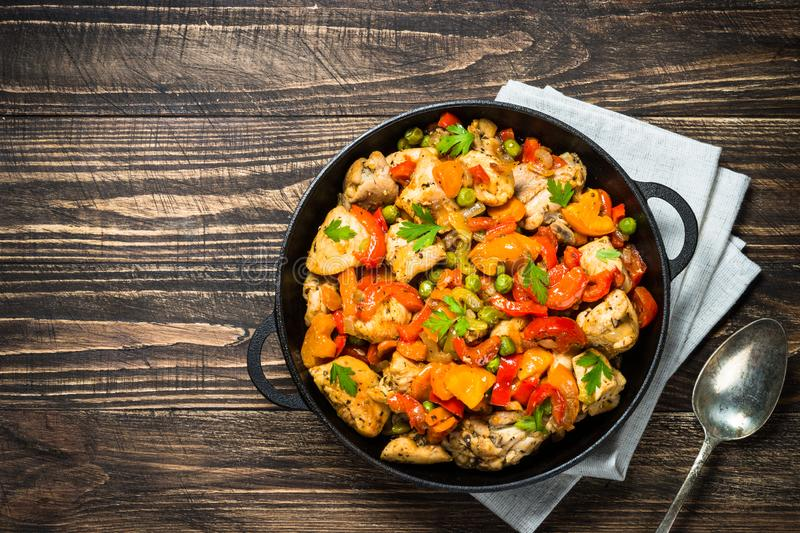 Chicken Stir fry with vegetables on wooden table. royalty free stock photos