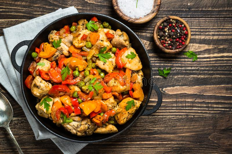 Chicken Stir fry with vegetables on wooden table. stock images