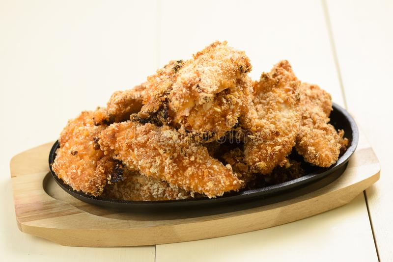 Chicken strips - meat in crispy batter stock photos