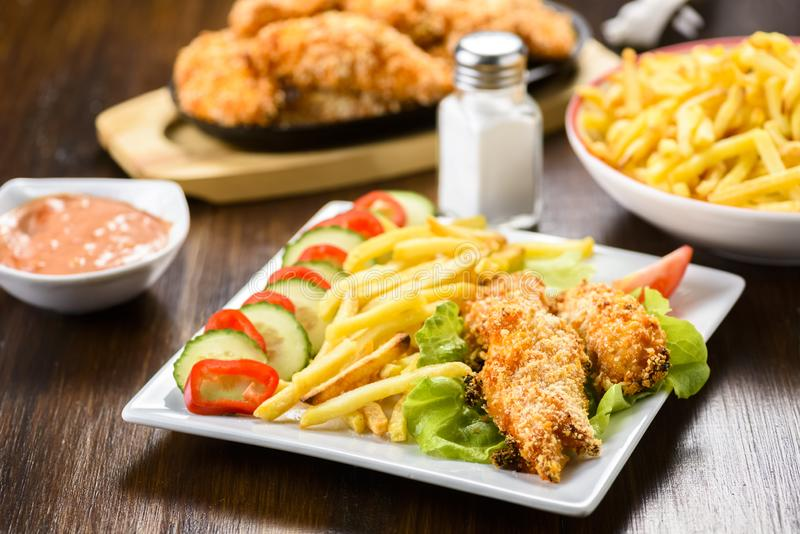 Chicken strips and fries stock images