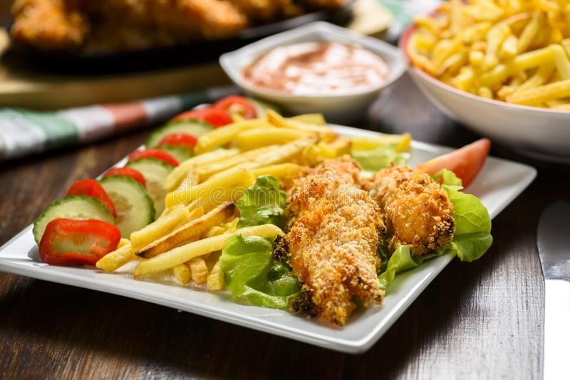 Chicken strips and fries royalty free stock image
