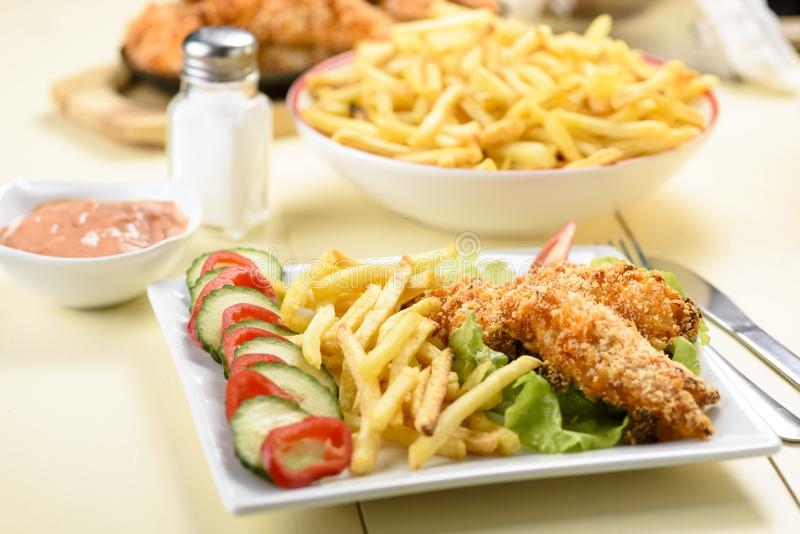 Chicken strips and fries royalty free stock photo