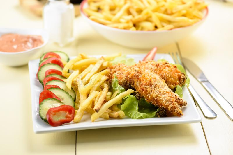 Chicken strips and fries royalty free stock photos