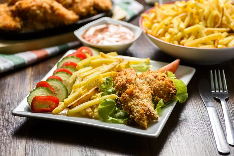 Chicken strips and fries stock image