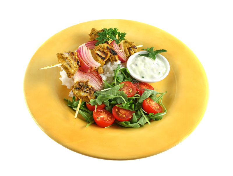 Chicken Tandoori Skewers. With red onion and a rocket salad royalty free stock image