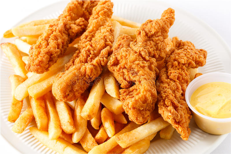 Chicken Tenders with Fries. Fried Chicken Tenders with French Fries and Dipping Sauce royalty free stock photos