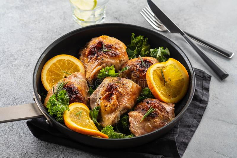 Chicken thighs with orange is a pan. stock images
