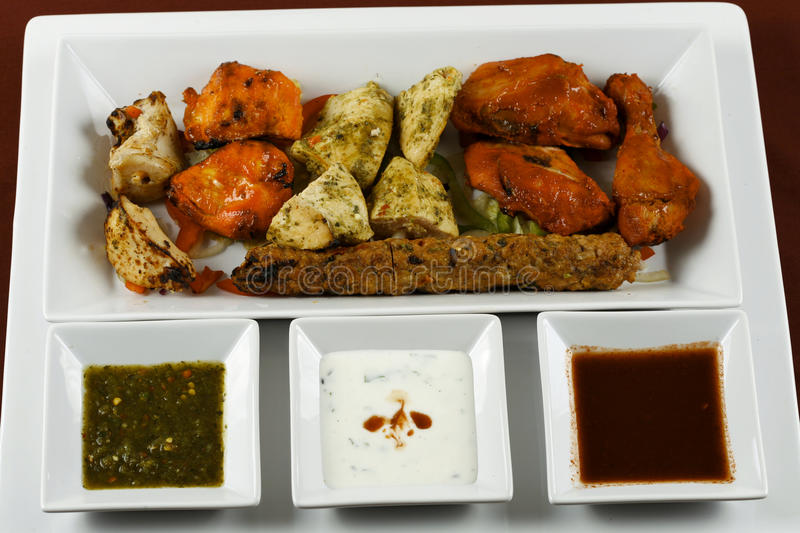 Chicken tikka. Tandoori chicken in plater with salad stock image