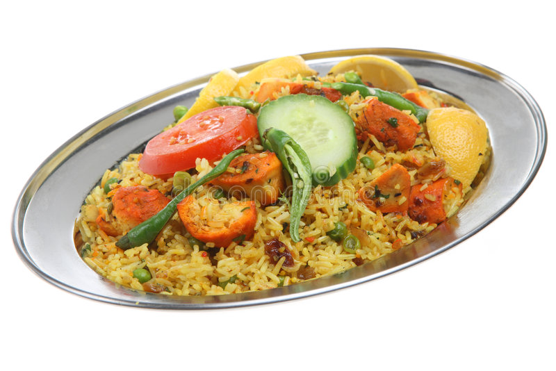 Chicken Tikka Biriani Curry. Spicy Indian curry dish on a stainless steel serving platter stock photography