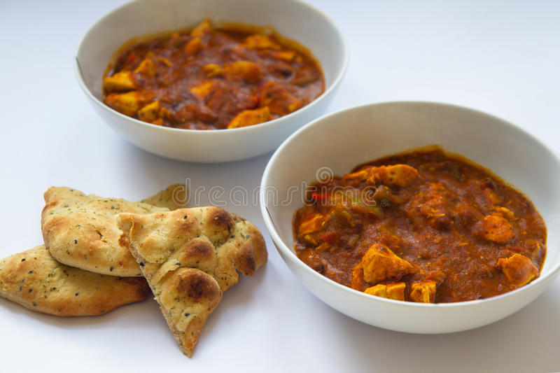 Chicken Tikka Curry with Naan Bread royalty free stock photo