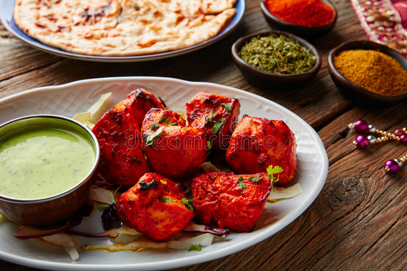 Chicken Tikka indian food recipe. With spices stock photos