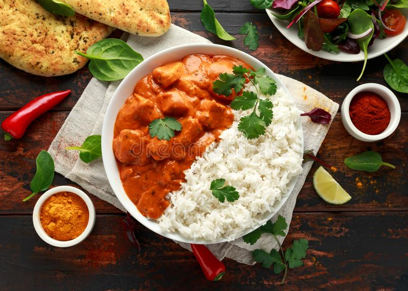Chicken tikka masala curry with rice and naan bread.  stock photo