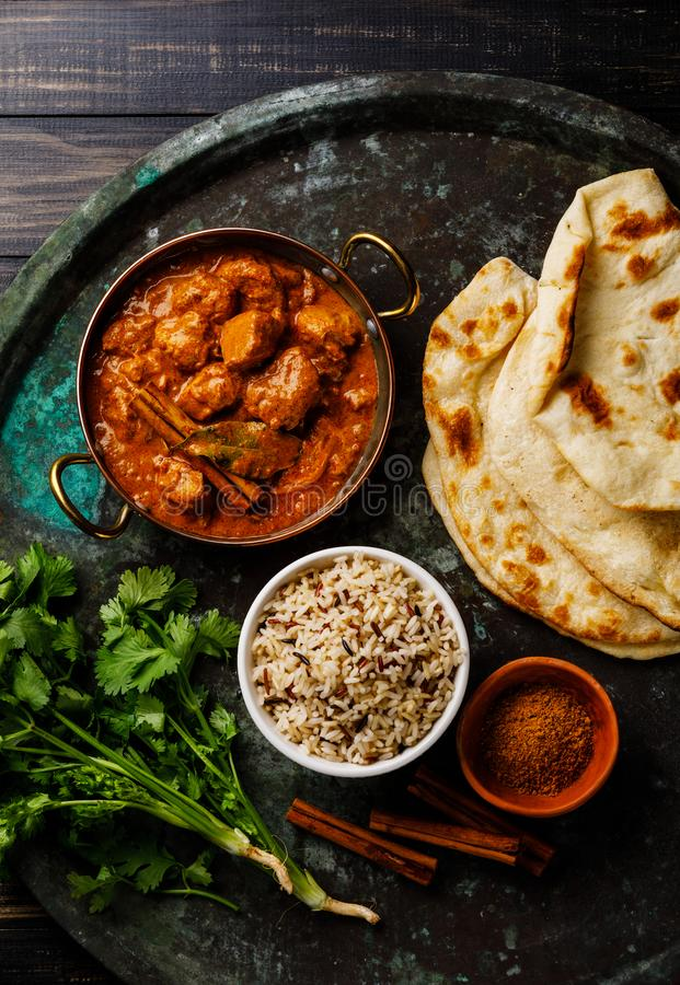Chicken tikka masala spicy curry meat food with rice. And naan bread on dark background royalty free stock photo