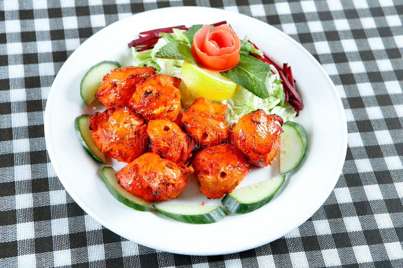 Chicken tikka with salad. Hot and spicy tandoori chicken tikka for snack time at restaurant royalty free stock images