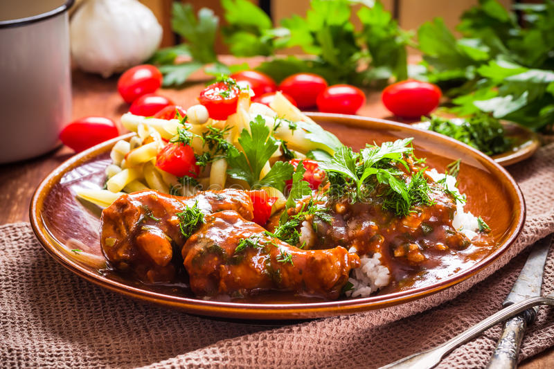 Chicken tomato sauce with rice and green beans. Chicken in tomato sauce with rice and green beans stock photo