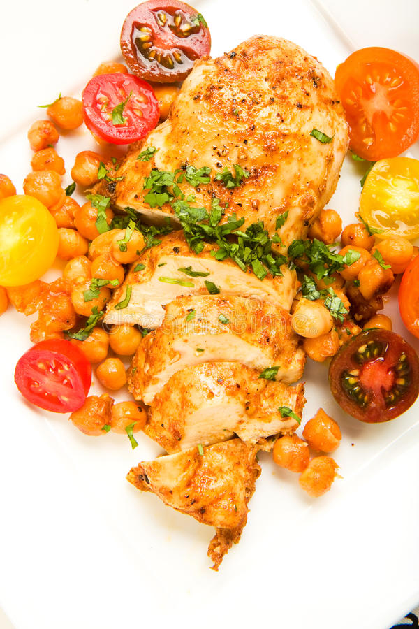 Chicken with tomatoes and Garbanzo Beans stock photo