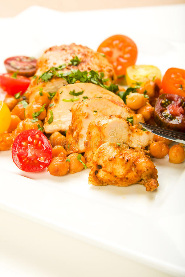 Chicken with tomatoes and Garbanzo Beans royalty free stock photo