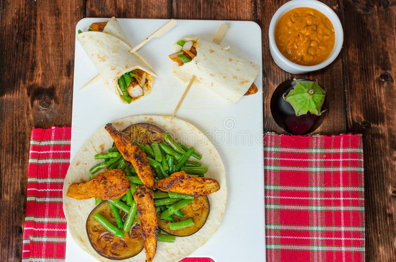 Chicken tortilla with beans and red curry stock photo