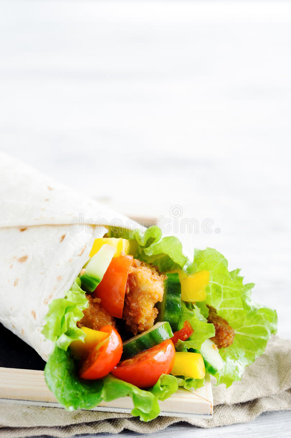 Chicken tortilla with salad stock image