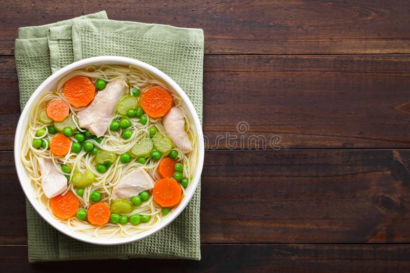 Chicken and Vegetable Noodle Soup stock images