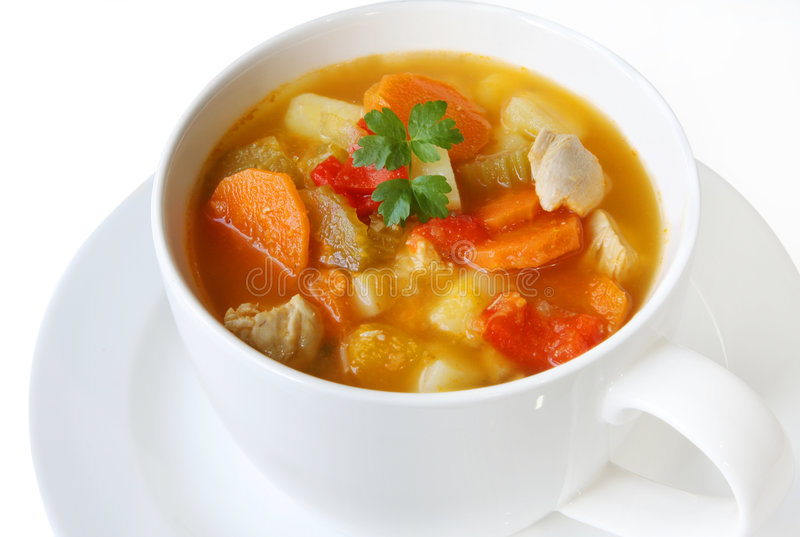Chicken and Vegetable Soup. In a white soup bowl royalty free stock image