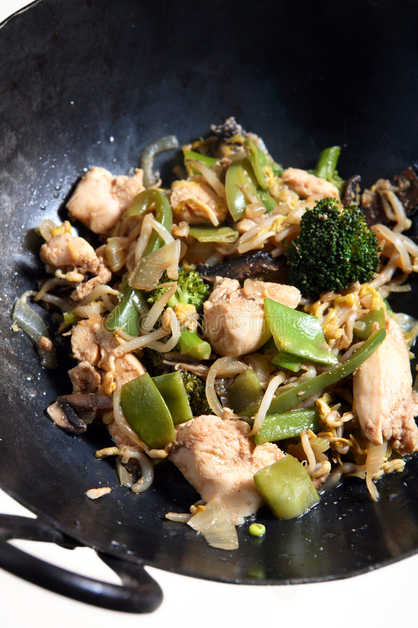 Chicken vegetable stir-fry in a wok. A chicken and vegetable stir fry in a wok, part of the ingredients for a chicken chow mein royalty free stock photos