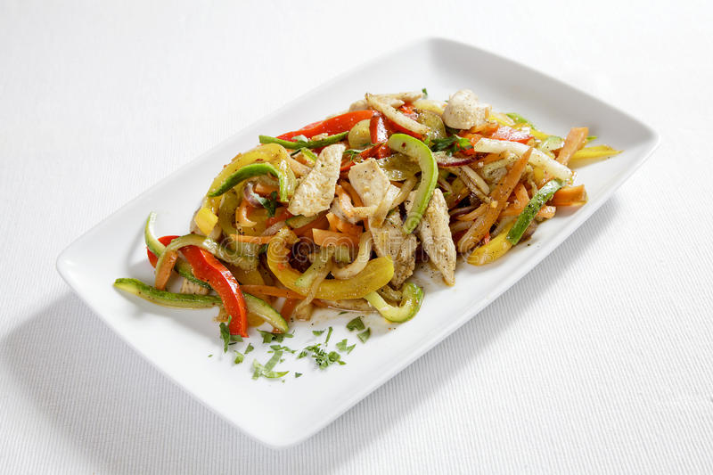 Chicken with vegetables. Italian chicken with coloured vegetables royalty free stock images