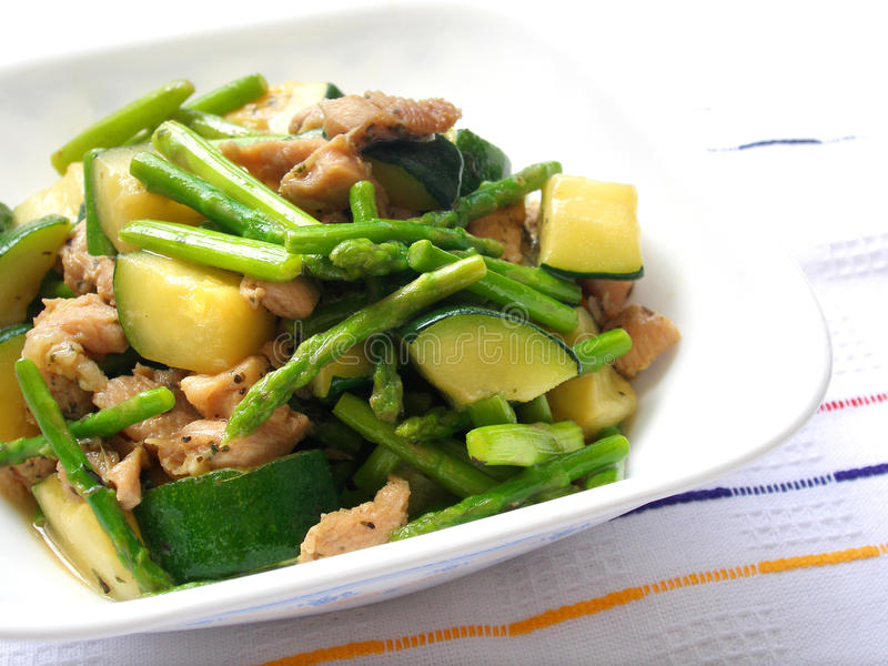 Chicken vegetables stiry fry stock images