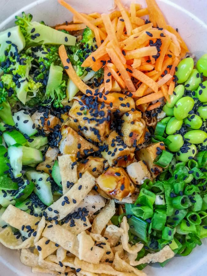 Chicken and veggie salad bowl stock images