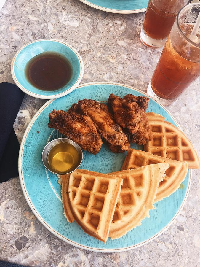 Chicken and waffles. Delicious chicken and waffles by the beach stock photos