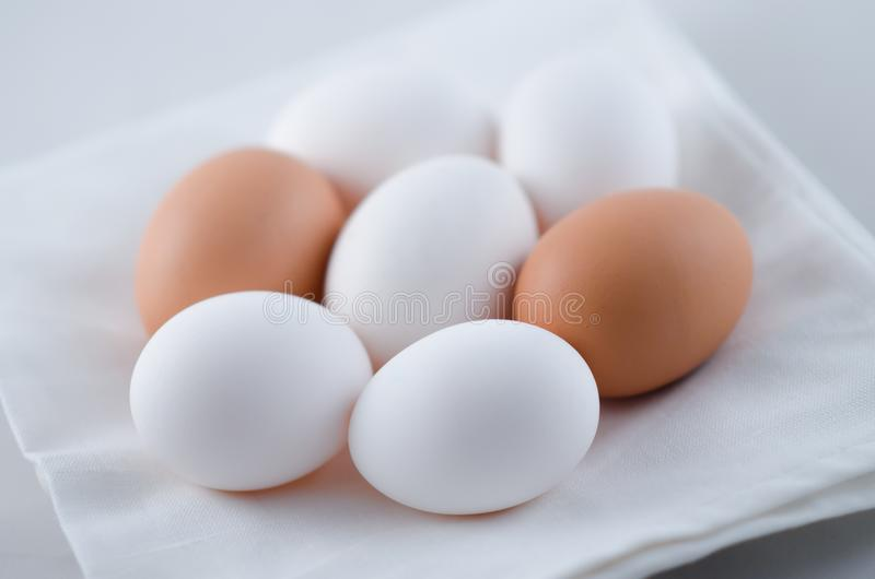 Chicken white and brown eggs on the napkin royalty free stock image