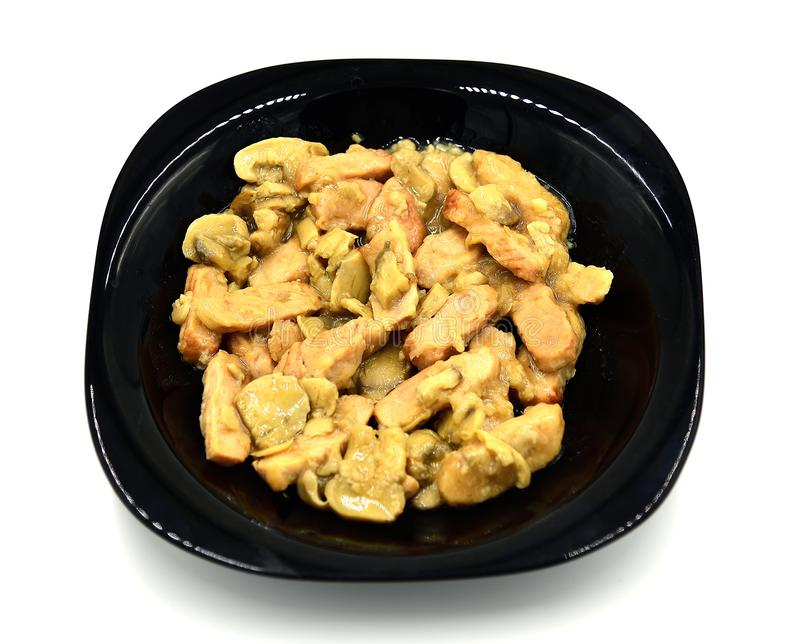 Chicken with White Wine and Mushrooms. A delicious plate of boneless, skinless, chicken breasts sauteed with white wine, basil, and mushrooms stock photography