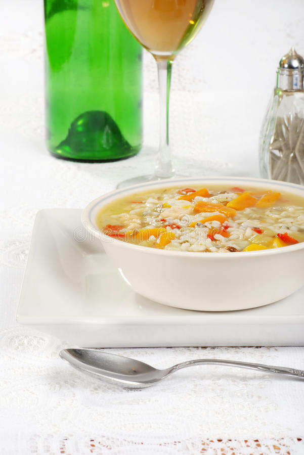 Chicken and wild rice soup with wine. Glass and bottle royalty free stock photos