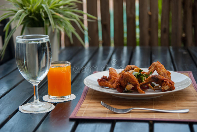 Chicken wing fried with herb stock photo
