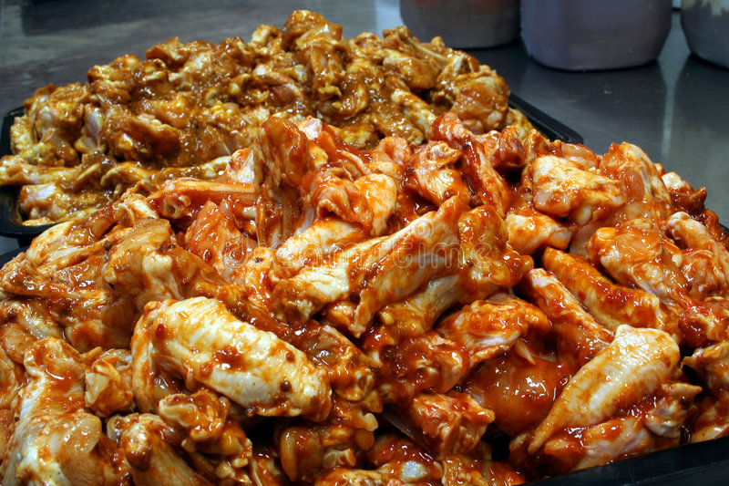 Chicken wing preperation 3 stock images