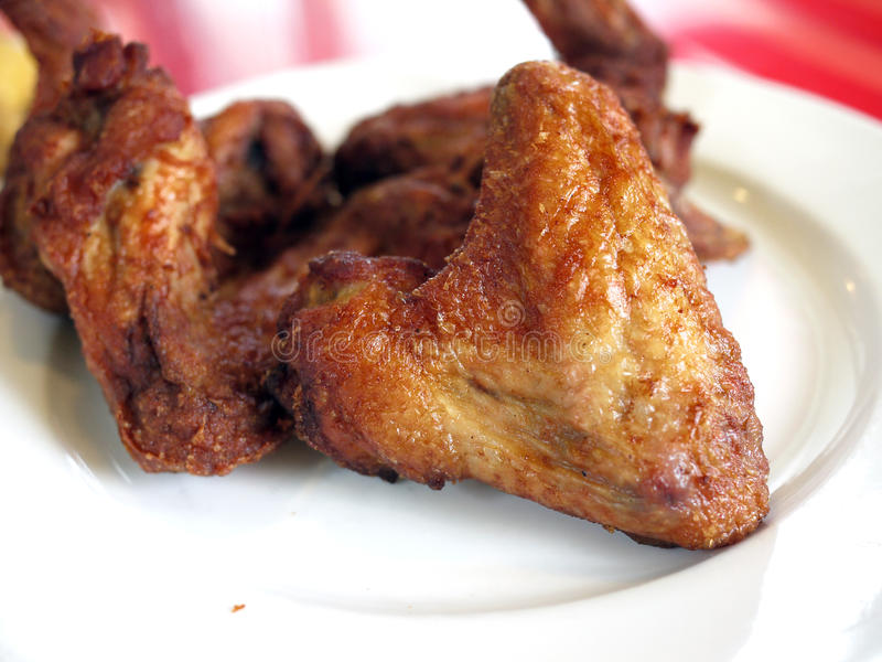 Chicken Wings. A plate of deep fried chicken wings stock image