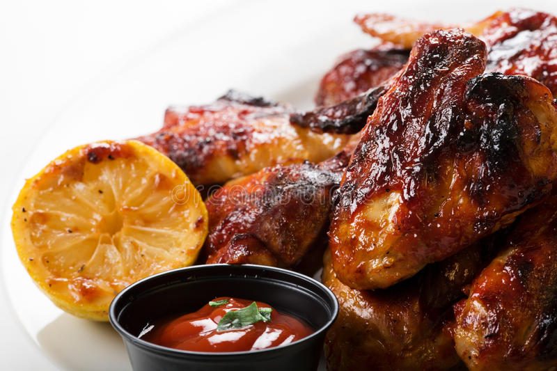 Chicken wings. Roasted chicken wings on plate royalty free stock images